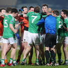 Ugly scenes: Armagh and Fermanagh players clash in the ill-disciplined encounter at the Athletic Grounds, the Orchard County edging victory by a point