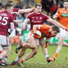 On the run: Armagh's Shea Heffron tries to shake off Eddie Hoare at the Athletic Grounds