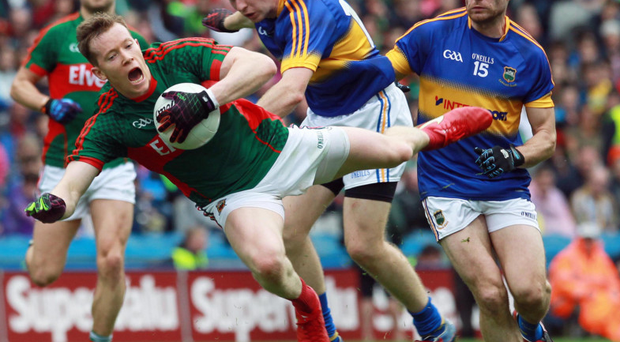 Hands on: Mayo's Cillian O'Connor gets to grips with Brian Fox of Tipperary in the All-Ireland semi-final