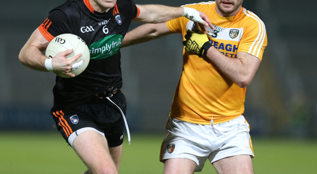 Close up: Armagh's Brendan Donaghy clashes with Patrick Gallagher