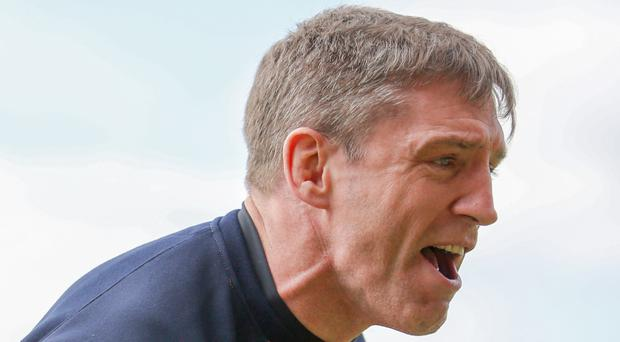 Sheer agony: Armagh boss Kieren McGeeney feels the pain of defeat