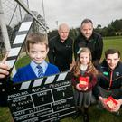 All stars: young players David Pietrzkieicz and Sophia McEvoy pictured with (back, from left) Jimmy Magee, St Peter's GAC, Richard Rogers of The Alpha Programme and Aaron Findon, Armagh GAA midfielder, at the St Peter's club grounds in Lurgan