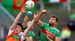 Packing a punch: Armagh's Aidan Nugent jumps with Colm Boyle and Aidan O'Shea of Mayo