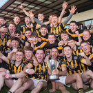 Party time: Crossmaglen Rangers celebrate their victory over Ballymacnab at the Athletic Grounds yesterday