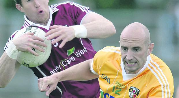 Conal Kelly is ready to step into the Antrim midfield