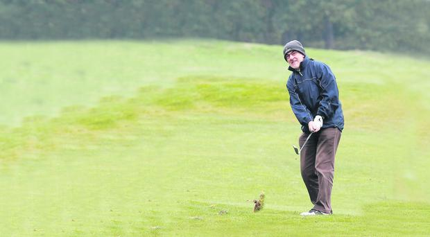 Tyrone manager Mickey Harte enjoys a round of golf