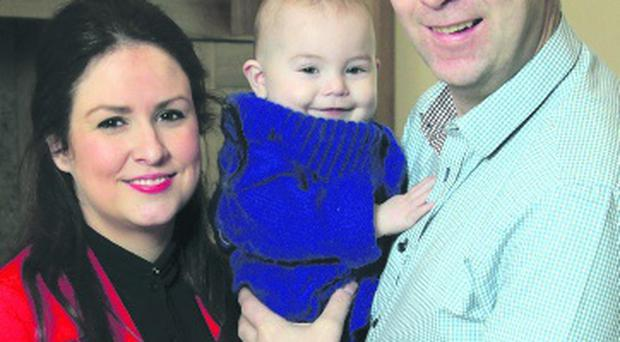 Oisin McConville pictured with wife Darina and son Ryan