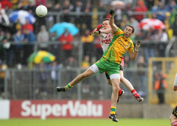 Donegal's Rory Kavanagh and Colm Cavanagh of Tyrone