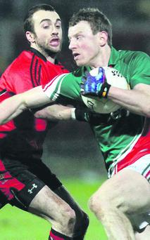 Down's Conor Laverty battles with Mayo's Colm Boyle