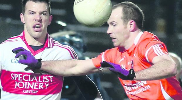 Armagh's James Lavery tries to block PJ McCloskey