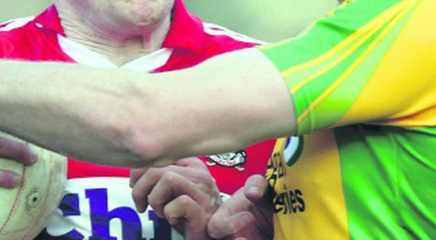 Andrew O'Sullivan of Cork and Donegal's Neil Gallagher clash