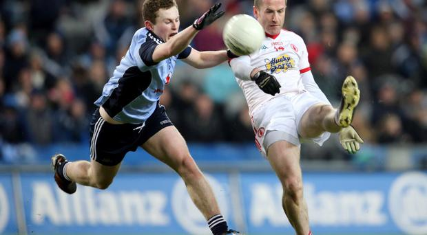 Tyrone's Stephen O'Neill (right) kicked four points at Croke Park