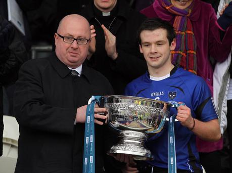 St Patrick's, Maghera captain Conor Carville is presented the Danske Bank MacRory Cup from Danny Stinton after defeating St Paul's in the final at the Athletic Grounds, Armagh