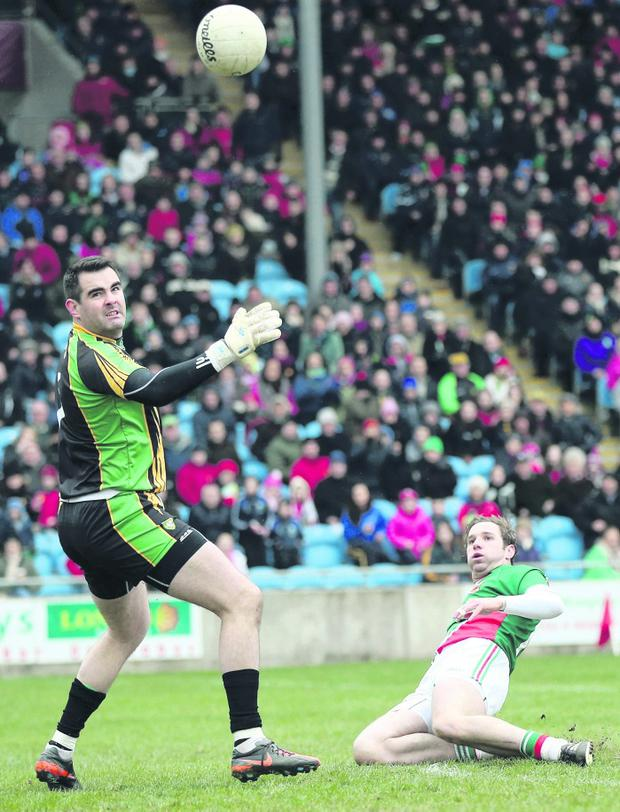 Mayo's Michael Conroy scores a goal past Donegal goalkeeper Paul Durcan