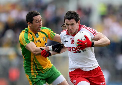 Donegal's Rory Kavanagh (left) and Tyrone's Mattie Donnelly battle it out for two Ulster sides expected to be in shake-up for honours this season