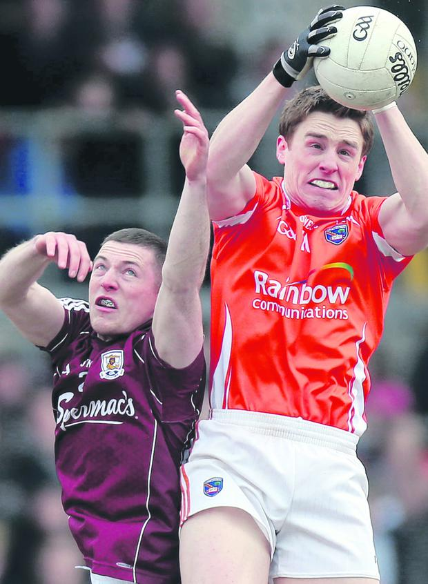 Armagh's Charlie Vernon jumps with Danny Cummins of Galway