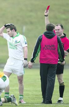 Referee Padraig O'Sullivan shows a red card to Fermanagh's Declan McCusker