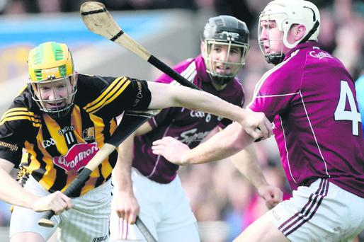 Kilkenny's Richie Power is tackled by Niall Donoghue of Galway
