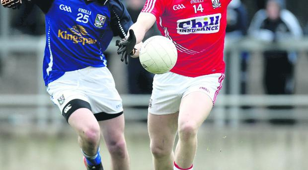 Cavan's Darragh McVitty and Brian Hurley of Cork