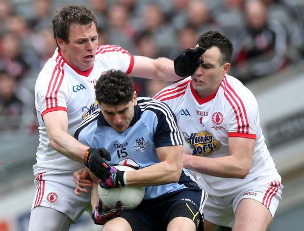 Dublin's Bernard Brogan with Cathal McCarron and Conor Gormley of Tyrone