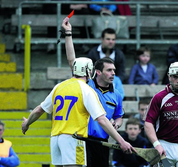 Antrim's Karl Stewart is shown a red card by referee James Owens