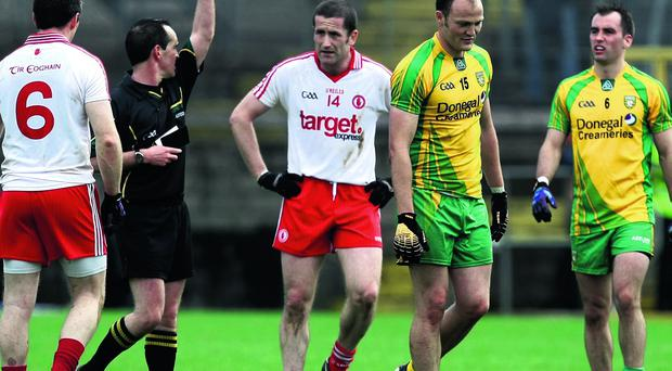 Donegal's Colm McFadden is shown a red card by referee David Coldrick during last year's Championship clash with Tyrone