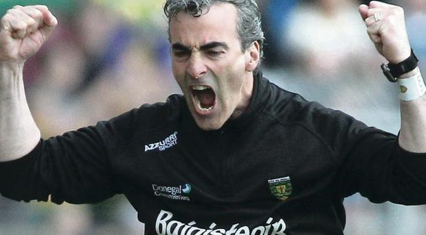 Donegal manager Jim McGuinness celebrates a score