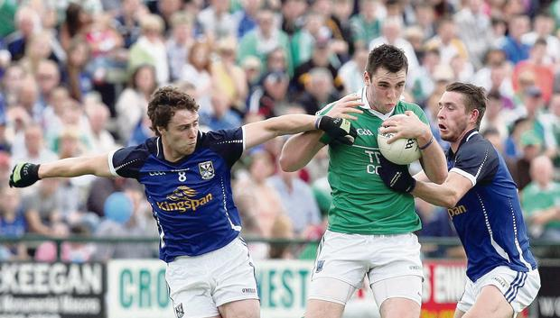 Ryan Jones of Fermanagh is closed down by Damien O'Reilly and David Givney of Cavan