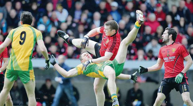 Donegal's Ryan Bradley jumps with Kalum King of Down