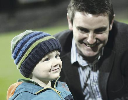 Support: Little Sam Bradley with his father Colm