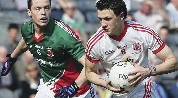 Race is on: Tyrone's Ronan Nugent and Stephen Coen of Mayo compete for All-Ireland honours in yesterday's minor final