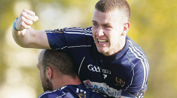 Champions: St Gall's Ruairi Wilson celebrates with teammate Aodhan Gallagher at the final whistle