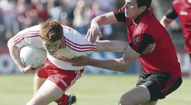 Reunited: Down's Declan Rooney with Tyrone's Peter Harte may face each other again