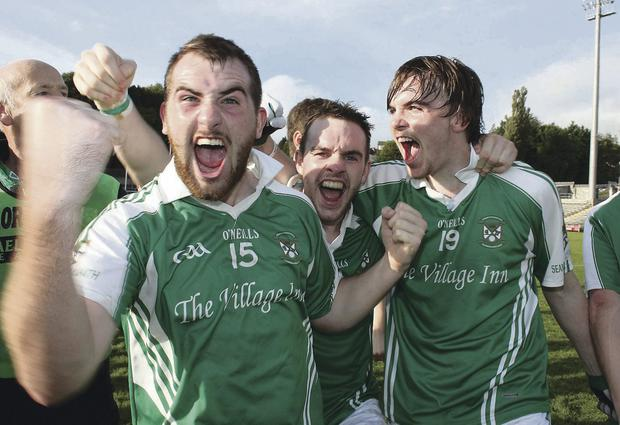 We've done it: Sean Quigley, Shane McMahon and Dermie Reilly of Roslea celebrate at the finish