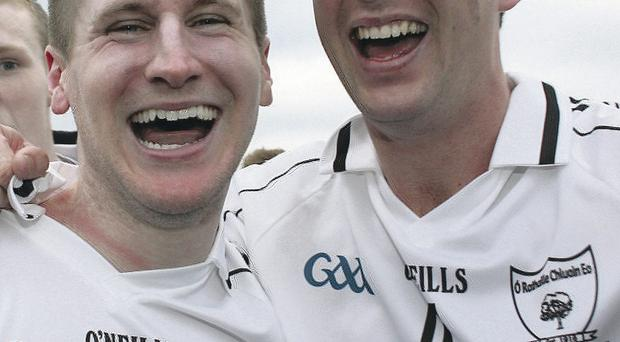 Winning smiles: Niall Kilpatrick and Colm Doris of Clonoe celebrate at the end of the game