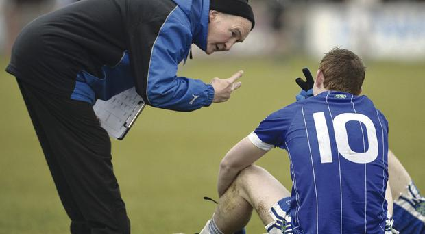 Aaron Devlin shows his disappointment following last year's defeat by Errigal Ciaran