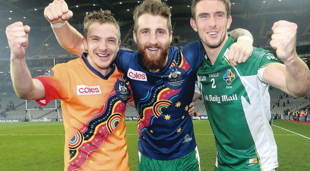 Job done: Ireland's Ross Munnelly, Zach Tuohy and Colm Begley celebrate at the finish