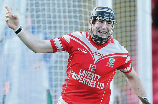 Road to victory: Loughgiel's Eddie McCloskey celebrates scoring