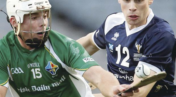 Close attention: Ireland's Darragh O'Connell holds off Fraser MacKintosh at Croke Park