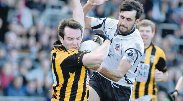 Kilcoo's Adrian Branagan battles with Crossmaglen's Tony Kernan