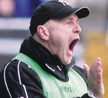 Jim McCorry celebrates at the final whistle