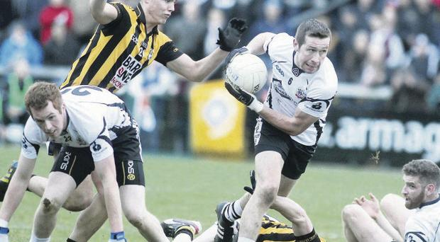 Big draw: The epic tussle between Kilcoo and Crossmaglen had fans flocking in for both the first game and the replay