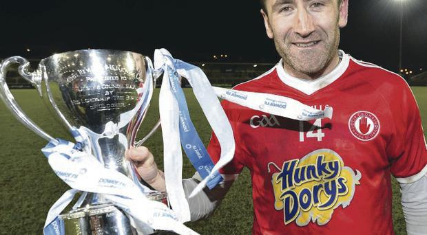 Winner: Tyrone's Stephen O'Neill with the McKenna Cup