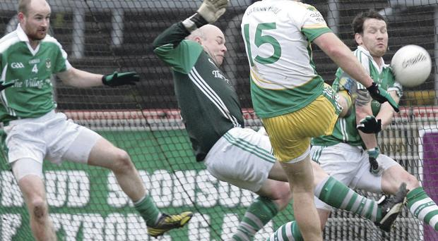 Back of the net: Glenswilly's Michael Murphy finds the net despite the attentions of Roslea's Conor Quigley, Sean Boyle and Niall Cassidy