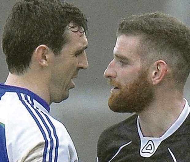Face to face: Ballinderry's Kevin McGuckin (left) and Kilcoo's Paul Greenan