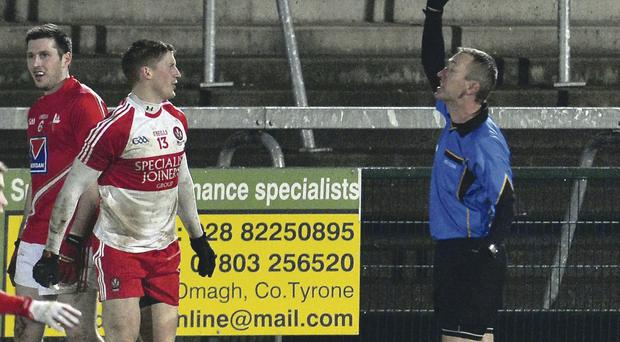 History made: referee Brendan Rice became the first person to use the black card against Derry's Declan Mullan