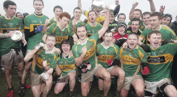 Hat-trick heroes: The Watty Grahams squad celebrate their third successive Ulster minor club football title