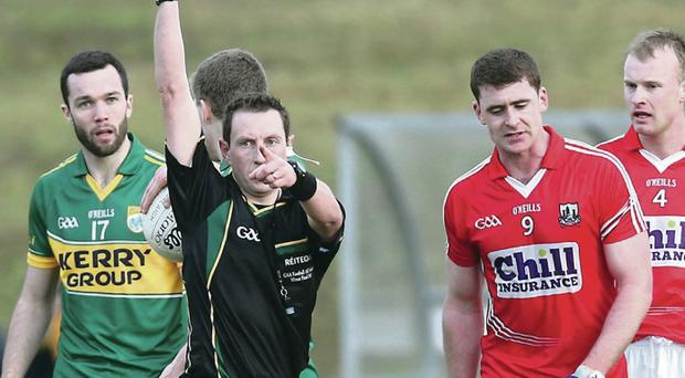 Take a break: Fintan Goold of Cork is shown a black card in the McGrath Cup final against Kerry on Sunday in Mallow