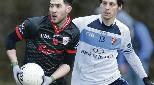 Sligo's Mark McHugh is closely watched by Jamie Clarke of Jordanstown during yesterday's Sigerson Cup tie