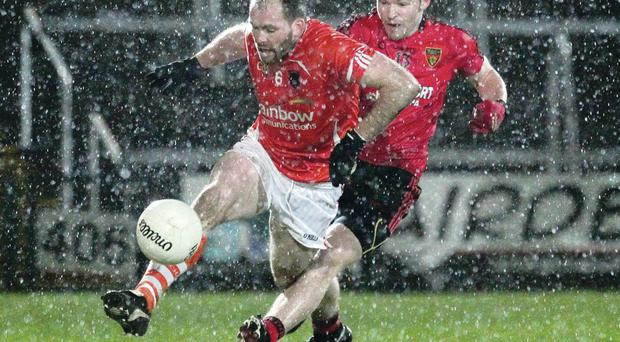 Armagh's Cairan McKeever moves away from Down's Donal O'Hare in tough conditions at the Athletic Grounds